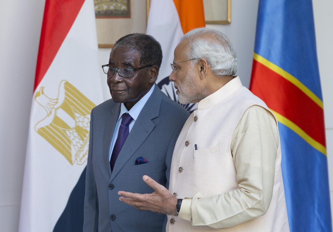 Indian Prime Minister Narendra Modi, right, speaks to Zimbabwe's President Robert Mugabe as they arrive for a bilateral meeting on the sidelines of the India Africa Forum Summit in New Delhi, October 28, 2015. (Photo/AP/Manish Swarup)