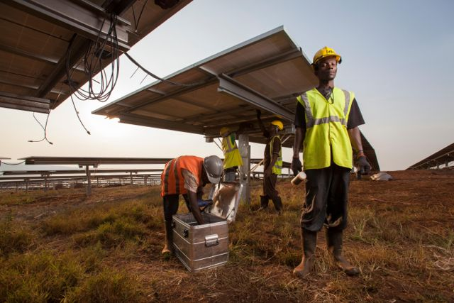Technician installing panels in one of East Africans largest Solar farm in Rwanda.(Photo/African Business)