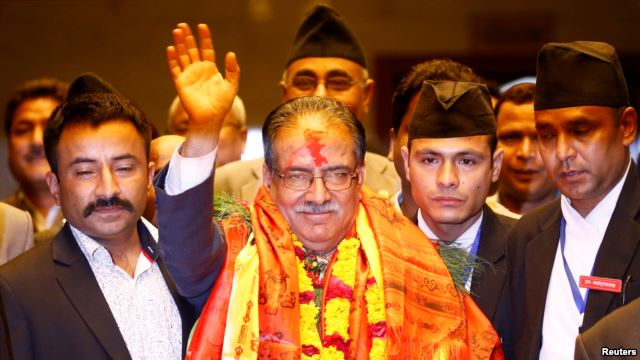 Nepal's newly elected Prime Minister Pushpa Kamal Dahal, also known as Prachanda, waves towards the media after he was elected Nepal's 24th prime minister in 26 years, in Kathmandu, Nepal, August 3, 2016. (Photo/Reuters)