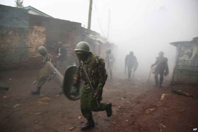 Riot police are caught in tear gas during running battle with opposition supporters in Kibera Slums in Nairobi, Kenya,October 26, 2017. (AP)