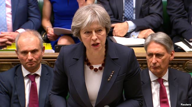 Britain's Prime Minister Theresa May addresses the House of Commons on her government's reaction to the poisoning of former Russian intelligence officer Sergei Skripal and his daughter Yulia in Salisbury, in London, March 14, 2018. (Reuters)