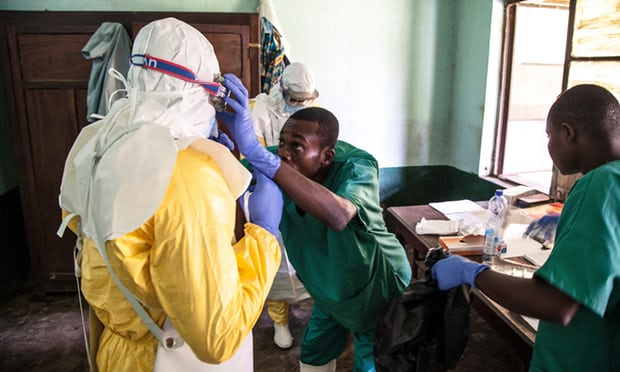 Health workers preparing to diagnose and treat suspected Ebola patients in the Democratic Republic of the Congo. (EPA/Mark Naftalin)