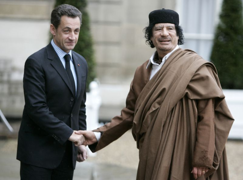 FILE - In this December 10, 2007. French President Nicolas Sarkozy, left, greets former Libyan leader Colonel Moammar Gadhafi upon his arrival at the Elysee Palace, in Paris. (AP/Francois Mori)
