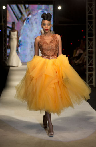 A model wears a creation by Elie Kuame, of Lebanon and Ivory Coast, at Hotel des Almadies, in Dakar, Senegal, Saturday, June 22, 2013. (AP/Rebecca Blackwell)
