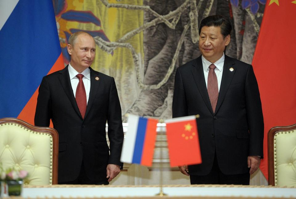 Russia's President Vladimir Putin, and China's President Xi Jinping, right, in Shanghai, China, May 21, 2014. (AP/RIA Novosti, Alexei Druzhinin)