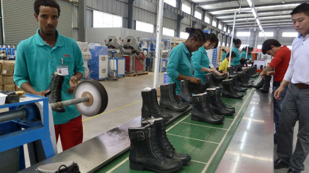 People working on the assembly line at Huajian shoe factory in Dukem, Ethiopia. (Jenny Vaughan/AFP/Getty Images)