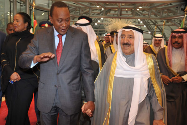 President Uhuru Kenyatta is welcomed by the Emir of Kuwait, His Highness Sheikh Sabah IV Al-Ahmad Al-Jaber Al-Sabah at Kuwait International Airport on November 18, 2013. (AFP/Rebecca Nduku)