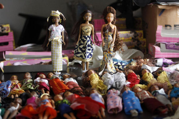Dolls dressed in local attire are arranged on a table at a workshop in Surulere district, in Nigeria's commercial capital Lagos, January 8, 2014. (Reuters/Akintunde Akinleye)