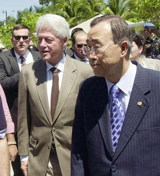 U.N. Secretary-General Ban Ki-moon and former President Bill Clinton visit a Port-au-Prince slum in March 2009. Ban has named Clinton the U.N.'s envoy to Haiti. AFP/Getty Images