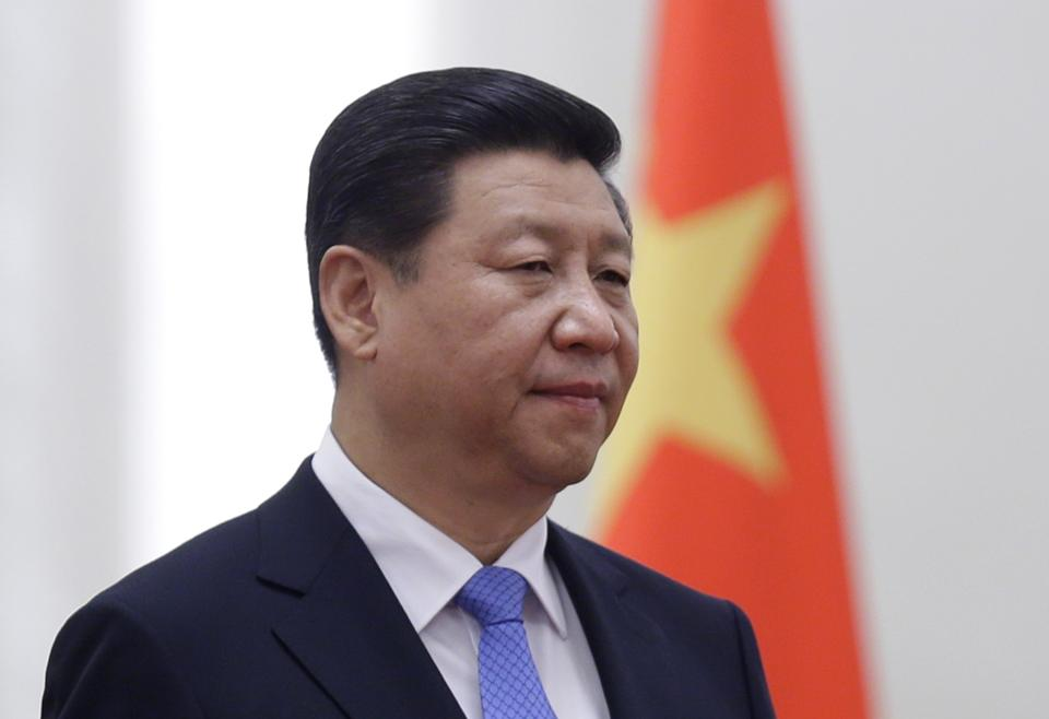 File photo of China's President Xi Jinping standing next to a Chinese national flag in Beijing in this November 13, 2013. (Photo: REuters/Jason Lee)