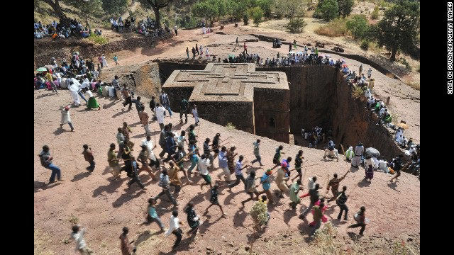 Ethiopian Orthodox Christians dance near to the rock-hewn church Bete Giyorgis during the annual festival of Timkat in Lalibela, Ethiopia. Bete Giyorgis is one of the 13th century-era medieval, monolithic cave churches in Lalibela. (Image - Getty Images)
