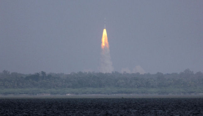 The Polar Satellite Launch Vehicle (PSLV-C25) rocket lifts off carrying India's Mars spacecraft from the east-coast island of Sriharikota, India, November 5, 2013. (AP/Arun Sankar K)