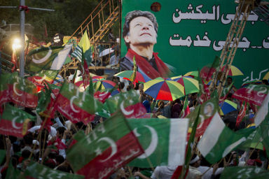 Supporters of Pakistan's Imran Khan wave their party flags at a rally in Islamabad, Pakistan, August. 16, 2014. (AP/B.K. Bangash)
