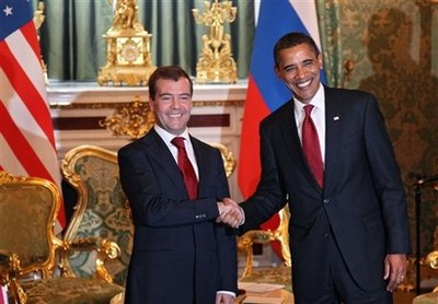 Russian President Dmitry Medvedev, left, and U.S. President Barack Obama shake hands while meeting at the Kremlin in Moscow, Russia, Monday, July 6, 2009. Presidents Barack Obama and Dmitry Medvedev end a seven-year hiatus in U.S.-Russian summitry on Monday, with each declaring his determination to further cut nuclear arsenals and repair a badly damaged relationship. (AP Photo/Anatoly Maltsev, Pool)