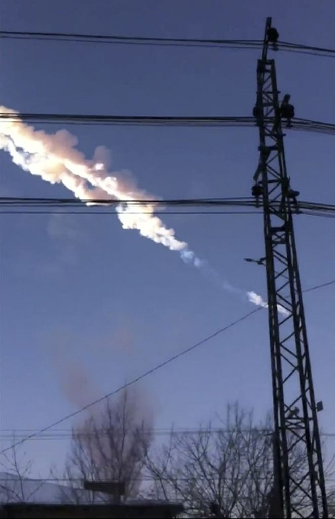 Meteorite contrail is seen in Chelyabinsk region on Friday  February 15, 2013. (AP/ Sergey Hametov)