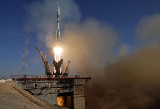 The Soyuz-FG rocket booster with Soyuz TMA-11M space ship carrying new crew to the International Space Station, ISS, blasts off at the Russian leased Baikonur cosmodrome, Kazakhstan, November 7, 2013.  (AP/Dmitry Lovetsky)