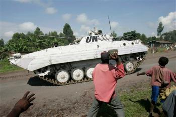 People angry over the United Nations failure to protect them stone peacekeepers in an armored personnel carrier as they pass through the village of Kibati some 12 kilometers north of Goma, Congo in this Oct. 28, 2008, file photo. (AP Photo/Karel Prinsloo)