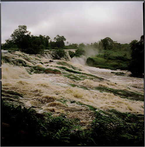 The Ivindo River in Gabon's Ivindo National Park flows down rapids and then into Kongou Falls. A dam project to power a Chinese-financed iron ore mining venture is threatening to destroy the falls. (Photo: Candace Feit for The New York Times)