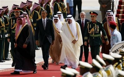 U.S. President Barack Obama, left, is greeted by King Abdullah of Saudi Arabia, right, during the arrival ceremony at King Khalid International Airport, Wednesday, June 3, 2009 in Riyadh, Saudi Arabia. (AP Photo/Pablo Martinez Monsivais)