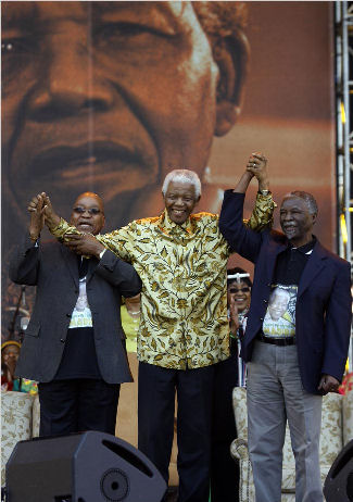 Jacob Zuma, left, and Thabo Mbeki, right, celebrate the birthday of Nelson Mandela shortly before Mr. Zuma's supporters forced out Mr. Mbeki as South Africa's president.  (AP/Jerome Delay)