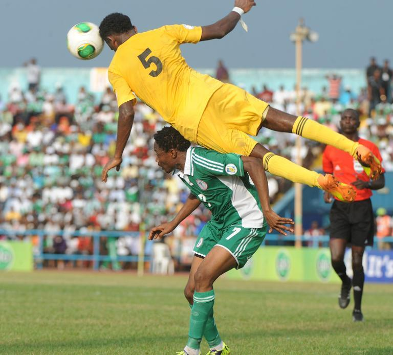 Ethiopia midfielder Hajlu Aynalem jumps on Nigerian attacker Ahmed Musa to head the ball during a FIFA World Cup qualifier in Calabar on November 16, 2013. (AFP/Pius Utomi Ekpei)