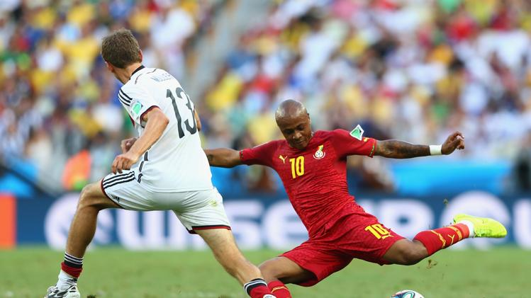 Andre Ayew of Ghana andThomas Mueller of Germany  World Cup 2014 on June 21, 2014 Brazil. (Getty Images/Michael Steele)