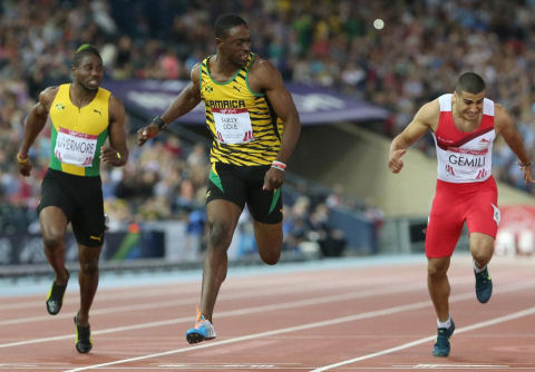 Kemar Bailey-Cole of Jamaica centre, wins the men's 100 meter at Hampden Park Stadium during the Commonwealth Games 2014 in Glasgow, Scotland,July 28, 2014. (AP/ Scott Heppell)